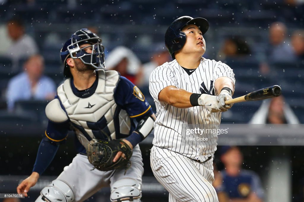 Ji-Man Choi #36 of the New York Yankees connects on a 2-run home run in the fourth inning against the Milwaukee Brewers at Yankee Stadium on July 7, 2017 in the Bronx borough of New York City.