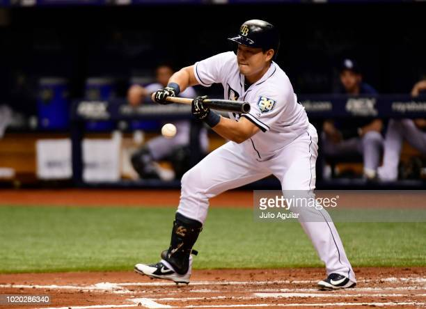 JiMan Choi of the Tampa Bay Rays bunts a single in the second inning against the Kansas City Royals on August 20 2018 at Tropicana Field in St...