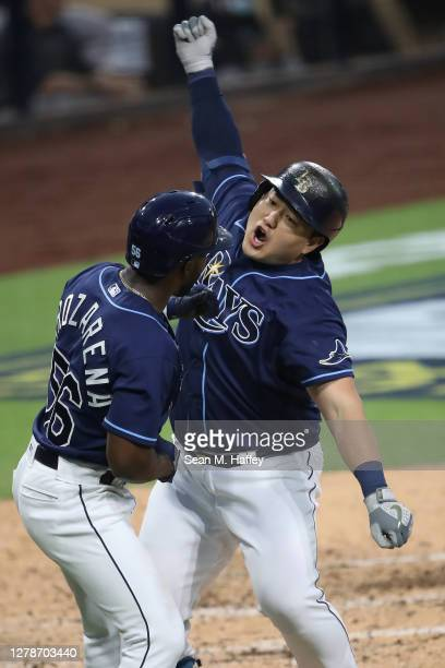 Ji-Man Choi of the Tampa Bay Rays celebrates a two run home run against the New York Yankees with teammate Randy Arozarena during the fourth inning...