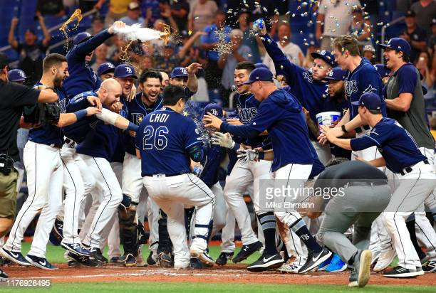 JiMan Choi of the Tampa Bay Rays celebrates a walk off home run in the 12th inning during a game against the New York Yankees at Tropicana Field on...