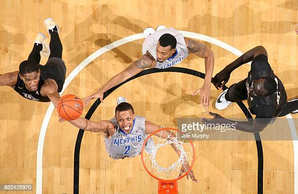 Jimario Rivers of the Memphis Tigers jumps for a rebound against A.J. Davis of the Central Florida Knights on January 22, 2017 at FedExForum in...