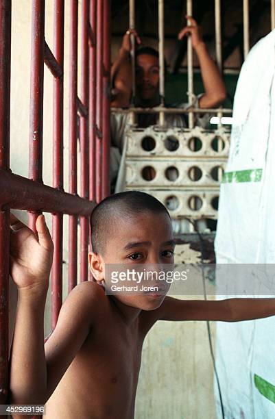 Jim-Boy, a six-year-old child who lives with his father in a cell, in the block for Batang City gang, one of four gangs at Manila City Jail. Manila...