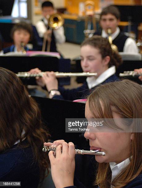 JimCoyleKiwanisMarch 22 2006Julia Clemens plays piccolo with the St Michael Catholic Wind Ensemble as they rehearse after school Wednesday March 22...