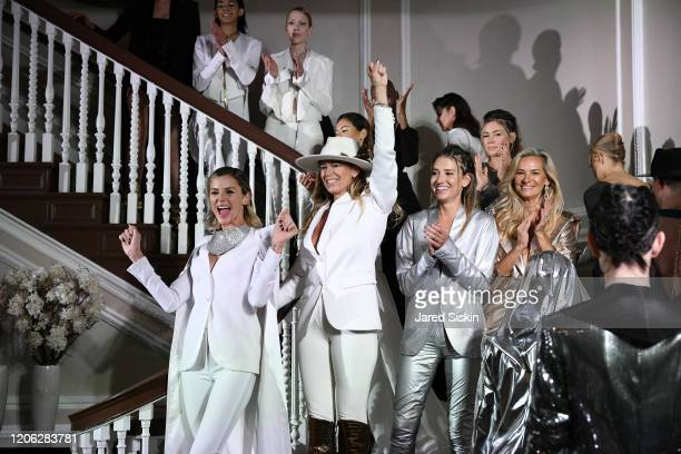 Jime Butti and Paola Rossi walk the runway with models during the finale at ROSSI TUXEDO New York Fashion Week Fall 2020 Collection at Consulate of...