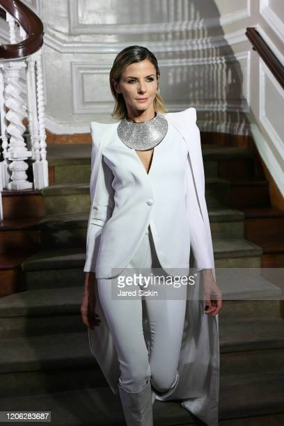Jime Butti walks the runway at ROSSI TUXEDO New York Fashion Week Fall 2020 Collection at Consulate of Argentina on February 11 2020 in New York City