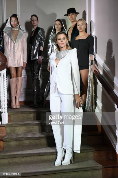 Jime Butti walks the runway with models during the finale at ROSSI TUXEDO New York Fashion Week Fall 2020 Collection at Consulate of Argentina on...