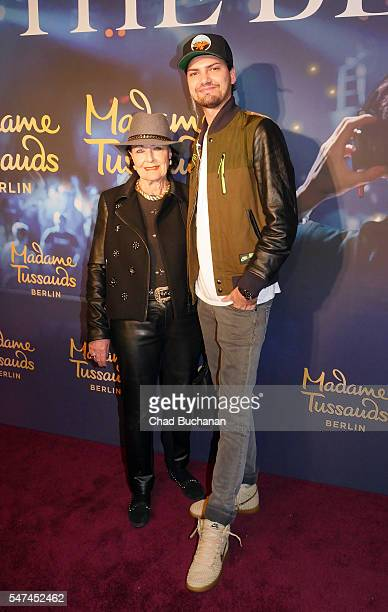 Jimi Blue Ochsenknecht and Baerbel Wierichs attends the unveiling of the Calvin Harris wax figure at Madame Tussauds on July 14 2016 in Berlin Germany