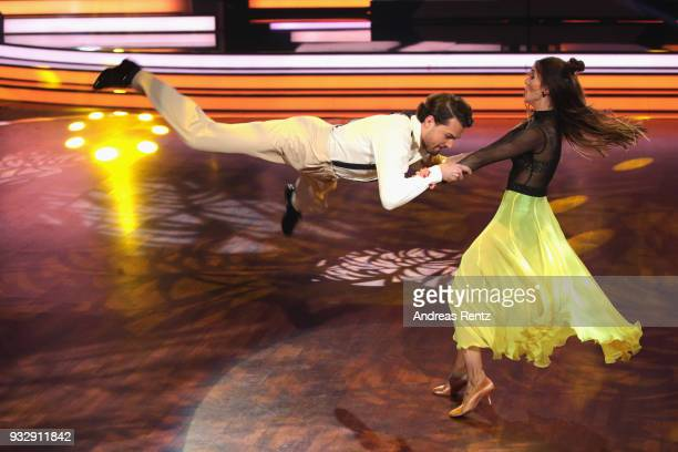 Jimi Blue Ochsenknecht and Renata Lusin perform on stage during the 1st show of the 11th season of the television competition 'Let's Dance' on March...