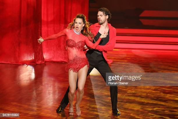 Jimi Blue Ochsenknecht and Renata Lusin perform on stage during the 3rd show of the 11th season of the television competition 'Let's Dance' on April...