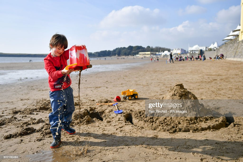 Jimi Cooke, 5, from Vale of Glamorgan, plays on Barry Island beach in South Wales during sunny weather as temperatures remain in single figures.