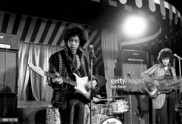 Jimi Hendrix and Noel Redding of The Jimi Hendrix Experience perform on stage in front of Marshall stack amplifiers at the Marquee Club in Wardour...