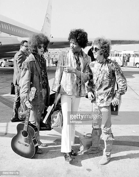 Jimi Hendrix arrives with members of his band The Jimi Hendrix Experience at Heathrow Airport London The group were in customs Hall for almost an...