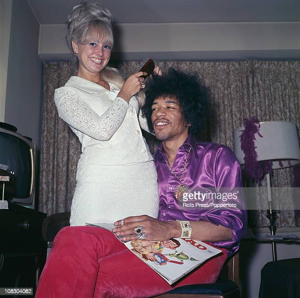 Jimi Hendrix having his hair done by a blonde lady circa 1968