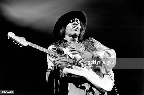 EAST Photo of Jimi HENDRIX performing live onstage playing white Fender Stratocaster guitar