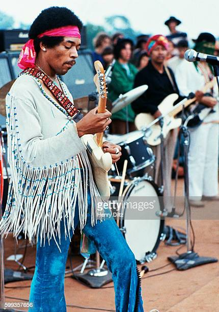 Jimi Hendrix playing his guitar during his set at the Woodstock Music and Art Fair Playing with Jimi Hendrix is Billy Cox | Location Near Bethel New...
