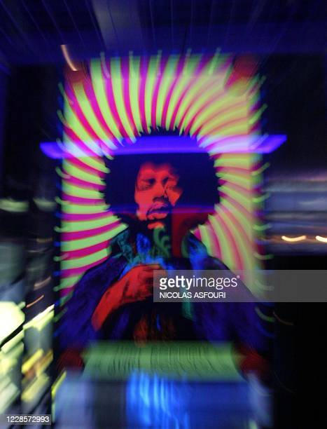 """Jimi Hendrix poster is on display at the Marquee club in London 16 September 2004. """"The Jimi Hendrix Experience"""" exhibition for the world's largest..."""