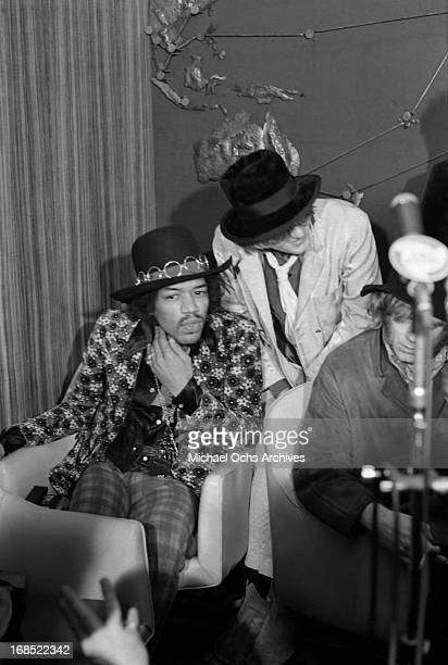 Jimi Hendrix Robert Wyatt and Henry McCullough pose for photos at a multi band press conference titled 'The British Are Coming' held at The Copter...