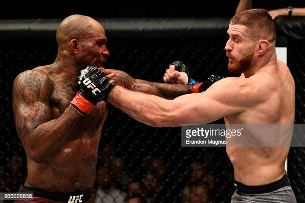 Jimi Manuwa and Jan Blachowicz of Poland exchange punches in their light heavyweight bout inside The O2 Arena on March 17 2018 in London England