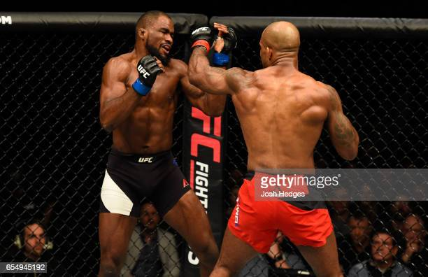 Jimi Manuwa of England punches Corey Anderson in their light heavyweight fight during the UFC Fight Night event at The O2 arena on March 18 2017 in...