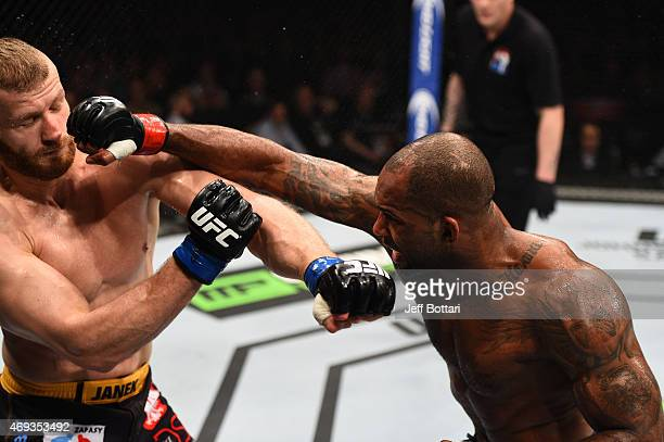 Jimi Manuwa of England punches Jan Blachowicz of Poland in their light heavyweight fight during the UFC Fight Night event at the Tauron Arena on...