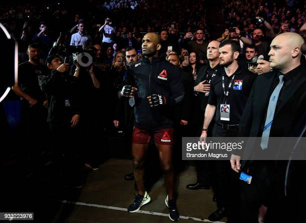 Jimi Manuwa walks out toward the Octagon prior to facing Jan Blachowicz of Poland in their light heavyweight bout inside The O2 Arena on March 17...