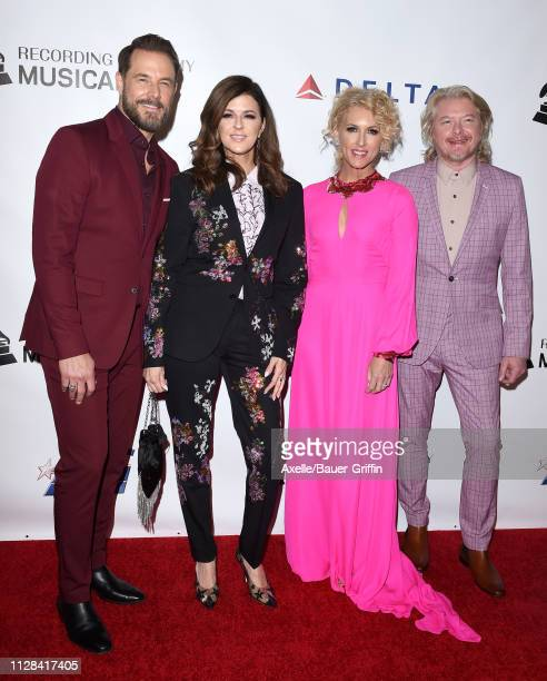 Jimi Westbrook Karen Fairchild Kimberly Schlapman and Philip Sweet of Little Big Town attend MusiCares Person of the Year honoring Dolly Parton at...