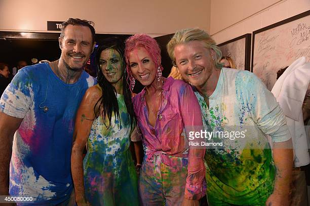 Jimi Westbrook Karen Fairchild Kimberly Schlapman and Philip Sweet of Little Big Town attend the 2014 CMT Music Awards at Bridgestone Arena on June 4...