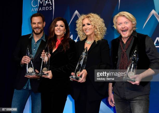 Jimi Westbrook Karen Fairchild Kimberly Schlapman and Philip Sweet of Little Big Town pose in the press room during the 51st annual CMA Awards at the...