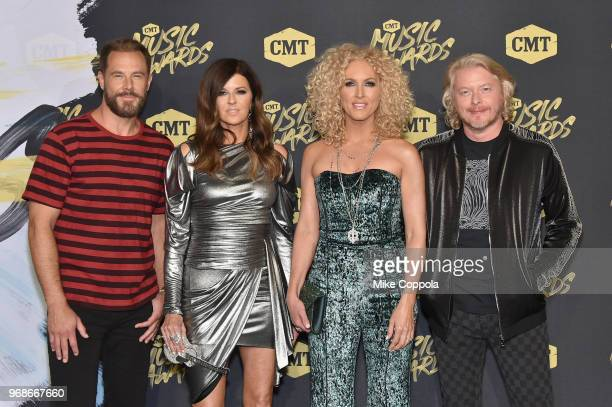 Jimi Westbrook Karen Fairchild Kimberly Schlapman and Philip Sweet of musical group Little Big Town attends the 2018 CMT Music Awards at Bridgestone...