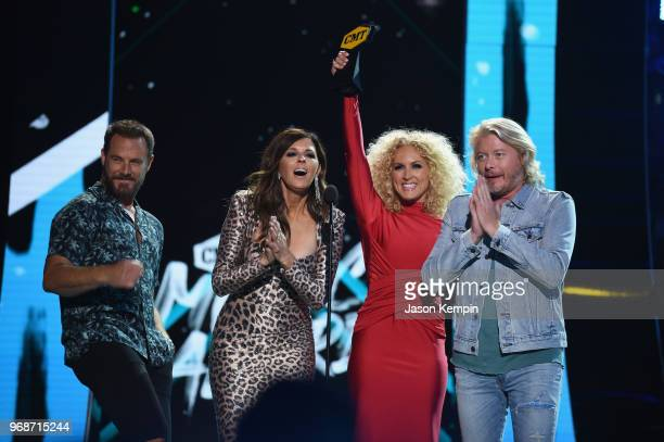 Jimi Westbrook Karen Fairchild Kimberly Schlapman and Philip Sweet of Little Big Town accept an award onstage at 2018 CMT Music Awards at Bridgestone...