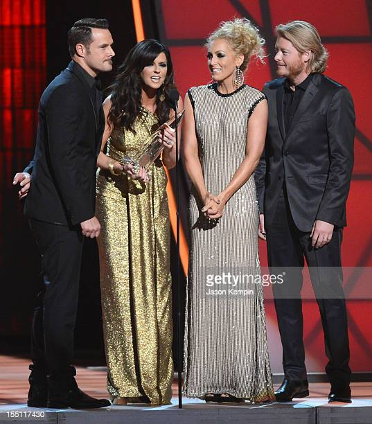 Jimi Westbrook Karen Fairchild Kimberly Schlapman and Phillip Sweet of Little Big Town attend the 46th annual CMA Awards at the Bridgestone Arena on...