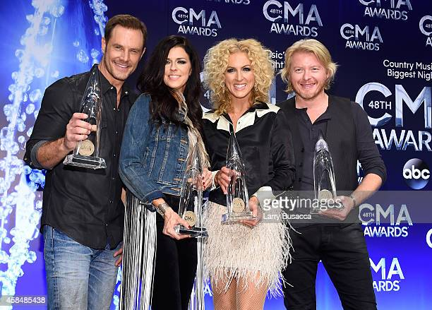 Jimi Westbrook Karen Fairchild Kimberly Schlapman and Phillip Sweet of Little Big Town pose in the press room after winning the award for Vocal Group...