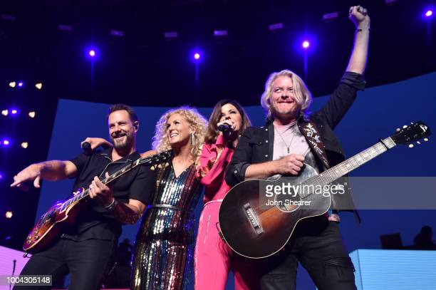 Jimi Westbrook Kimberly Schlapman Karen Fairchild and Philip Sweet of Little Big Town perform onstage during The Bandwagon Tour at Xfinity Center on...