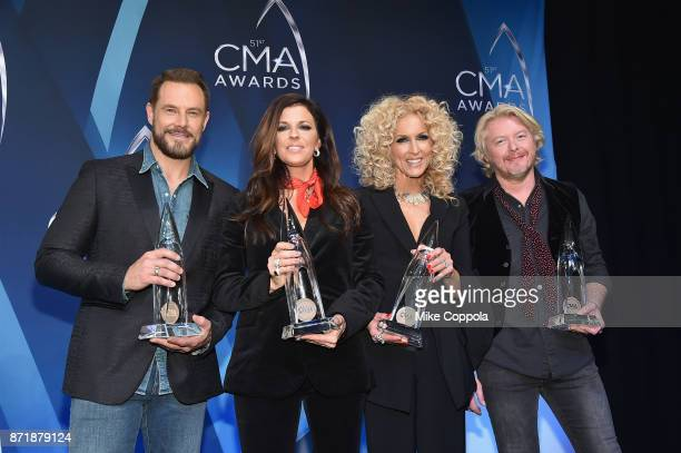 Jimi Westbrook Kimberly Schlapman Karen Fairchild and Philip Sweet of Little Big Town pose in the press room at the 51st annual CMA Awards at the...