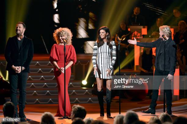 Jimi Westbrook Kimberly Schlapman Karen Fairchild and Philip Sweet of Little Big Town perform onstage for CMA 2017 Country Christmas at The Grand Ole...