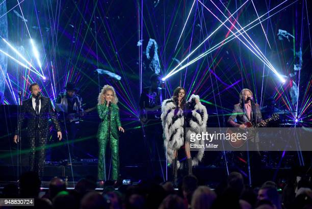 Jimi Westbrook Kimberly Schlapman Karen Fairchild and Philip Sweet of musical group Little Big Town perform during the 53rd Academy of Country Music...