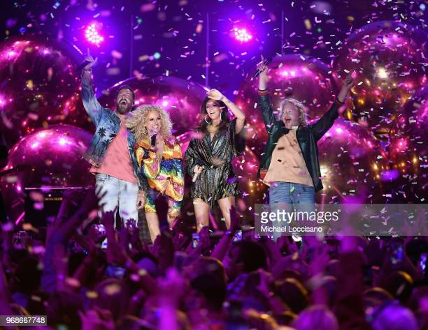 Jimi Westbrook Kimberly Schlapman Karen Fairchild and Philip Sweet of band Little Big Town perform onstage at the 2018 CMT Music Awards at...