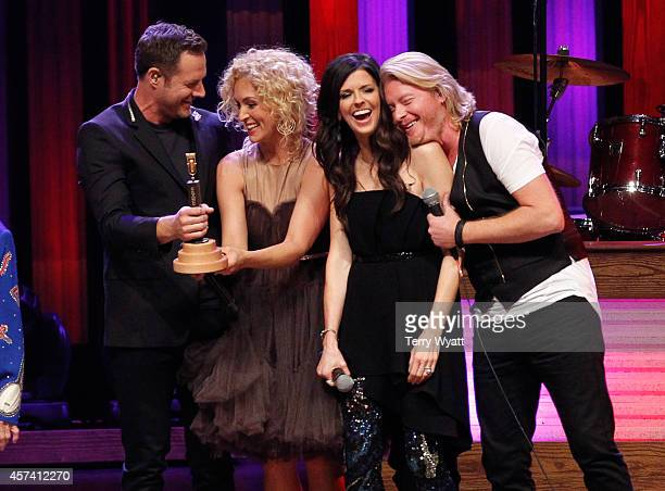 Jimi Westbrook Kimberly Schlapman Karen Fairchild and Phillip Sweet of Little Big Town is inducted as the newest member of The Grand Ole Opry on...
