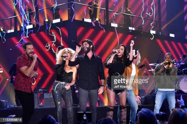 Jimi Westbrook Kimberly Schlapman Thomas Rhett Karen Fairchild Philip Sweet and Trombone Shorty perform onstage at the 2019 CMT Music Awards at...