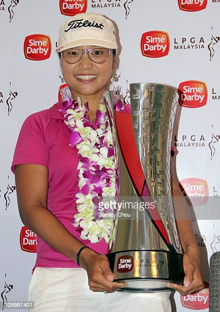 Jimin Kang of Korea poses with the Sime Darby LPGA Trophy after the final round of the Sime Darby LPGA on October 24 2010 at the Kuala Lumpur Golf...