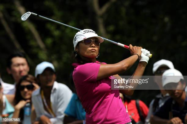 Jimin Kang of South Korea watches her tee shot on the 17th hole during the Final Round of the Sime Darby LPGA on October 24 2010 at the Kuala Lumpur...
