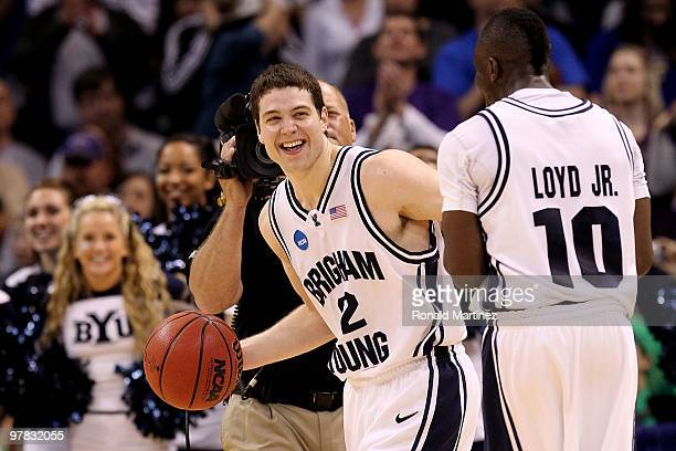 Jimmer Fredette and Michael Loyd Jr #10 of the BYU Cougars celebrate after BYU won in 9992 double in overtime against the Florida Gators during the...