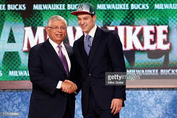 Jimmer Fredette from BYU greets NBA Commissioner David Stern after he was selected overall by the Milwaukee Bucks in the first round during the 2011...