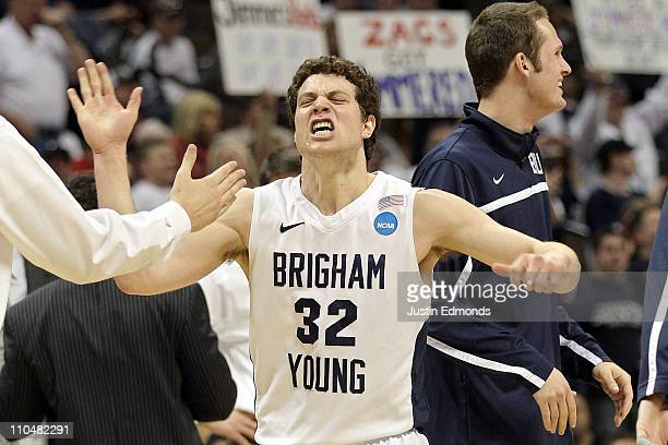 Jimmer Fredette of the Brigham Young Cougars celebrates after a play against the Gonzaga Bulldogs during the third round of the 2011 NCAA men's...