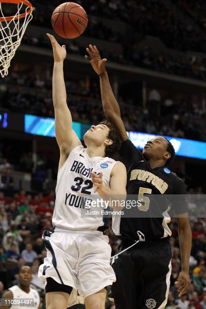 Jimmer Fredette of the Brigham Young Cougars goes to the hoop against Jamar Diggs of the Wofford Terriers during the second round of the 2011 NCAA...