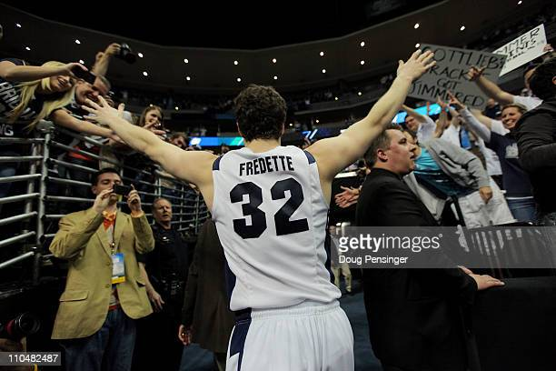 Jimmer Fredette of the Brigham Young Cougars runs off of the court after defeating the Gonzaga Bulldogs during the third round of the 2011 NCAA men's...