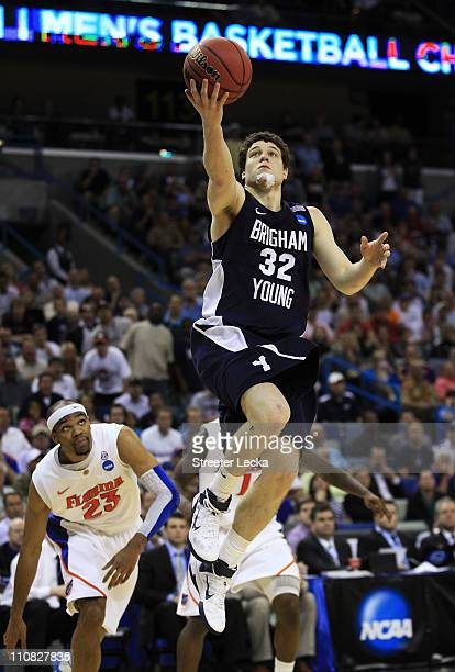 Jimmer Fredette of the Brigham Young Cougars shoots against the Florida Gators during the Southeast regional of the 2011 NCAA men's basketball...