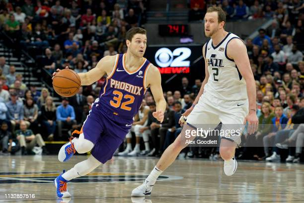 Jimmer Fredette of the Phoenix Suns drives around Joe Ingles of the Utah Jazz during a game at Vivint Smart Home Arena on March 25 2019 in Salt Lake...