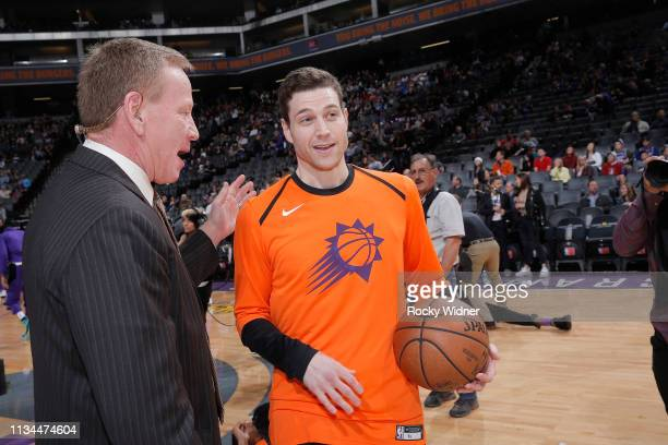 Jimmer Fredette of the Phoenix Suns greets announcer Grant Napear prior to the game against the Sacramento Kings on March 23 2019 at Golden 1 Center...