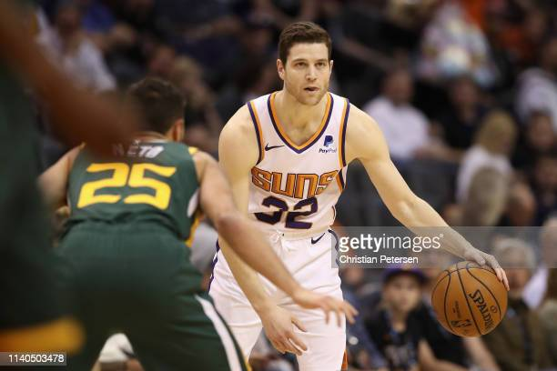 Jimmer Fredette of the Phoenix Suns handles the ball during the second half of the NBA game against the Utah Jazz at Talking Stick Resort Arena on...